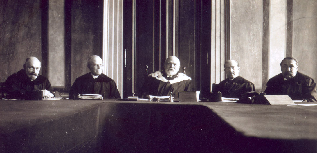 A senate of the Constitutional Court, 2nd half of the 1920s (In the middle: President Paul Vittorelli; second from the right: Hans Kelsen; second from the left: Friedrich Engel) [Provided by and used with permission of Anne Feder Lee, Ph.D.m granddaughter of Hans Kelsen]